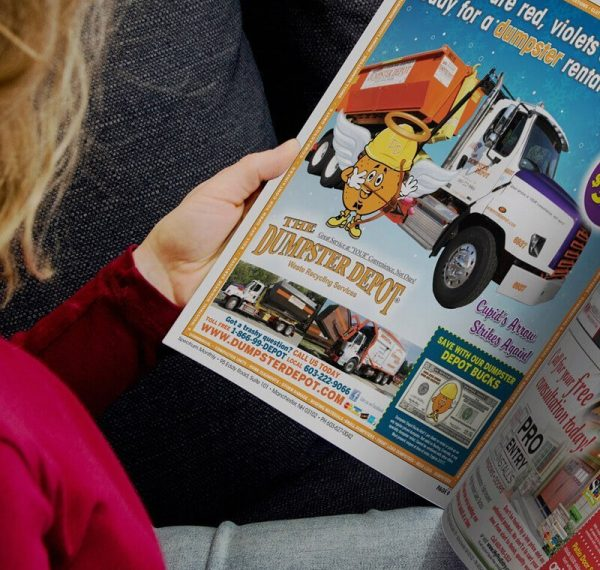 woman reading Spectrum Monthly coupon advertising book